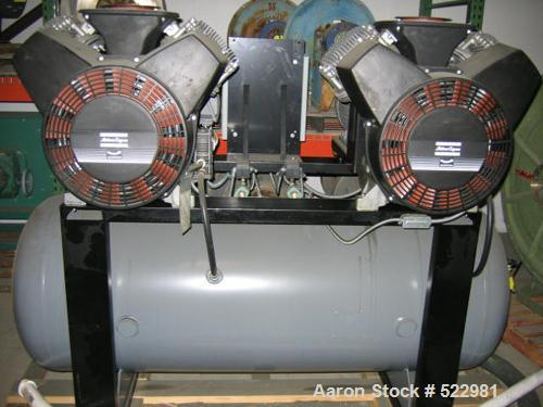 Unused-UNUSED: 100 cfm at 150 psi Atlas Copco high efficiency duplex aircompressor; two compressor/motor units mounted on co...