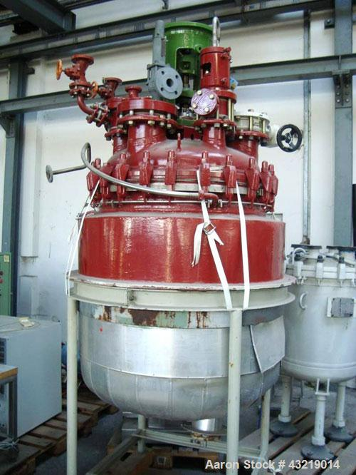 Used-  Glass Lined Reactor, 185.2 Gallon (700 Liter). No drive. Mounted on 4 legs.