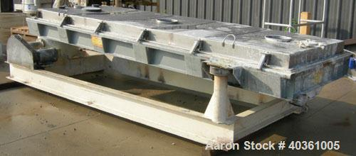 "Used- Rotex cooler, model 81C50. 304 stainless steel. Approximately 48"" wide x 12' long carbon steel jacketed bed. Nominal 5..."