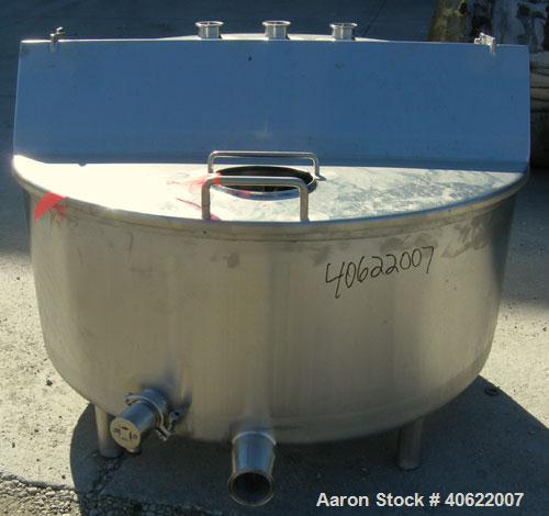"Used- Tank, approximate 70 gallon, 316 stainless steel, vertical. Approximate 37"" diameter x 15"" straight side.  1 piece ang..."