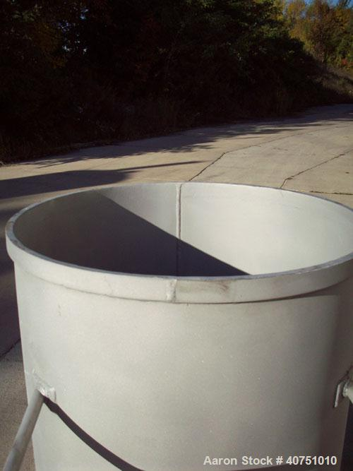 "Unused-155 Gallon Type 304L Stainless Steel Tank. 31"" inside diameter x 47"" deep. Open top with cover. Flat bottom. On caste..."