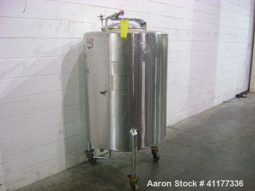 Used- Perma-San Tank, 150 Gallon, Stainless Steel, Vertical. Dished top, sloped bottom. Top manway. Mounted on 3 legs with c...