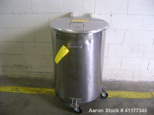 "Used- Tank, 60 Gallon, Stainless Steel, Vertical. 22-1/2"" diameter x 33"" straight side. Open top with hinged cover, flat bot..."