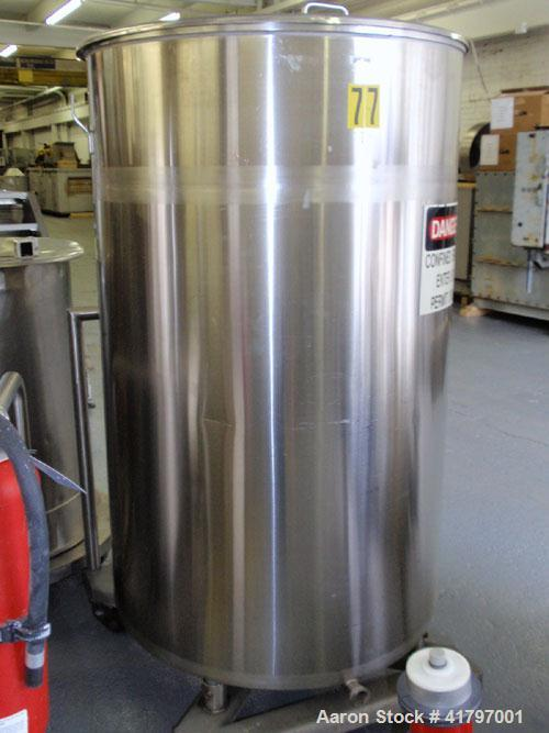 "Used- Tank, 250 Gallon, Stainless Steel, Vertical. 38"" diameter x 58"" staight side, open top with cover, flat bottom. 1-1/2""..."