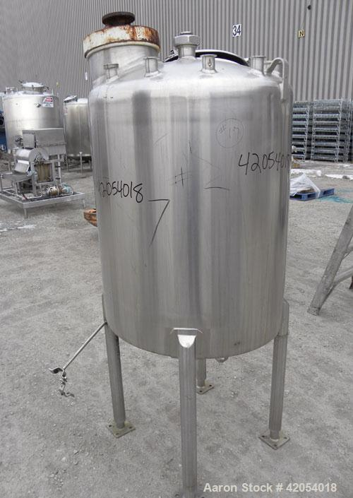 "Used- Tank, 100 Gallon, 316 Stainless Steel, Vertical. 30"" diameter x 36"" straight side, dish top, sloped bottom. 1-1/4"" dia..."