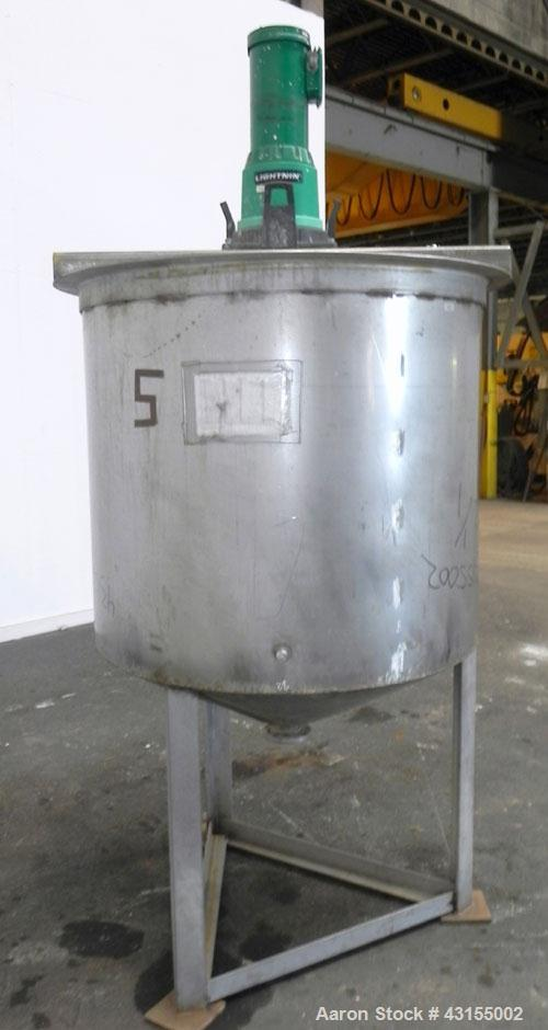 "Used- Tank, 275 Gallon, 304 Stainless Steel, Vertical. Approximate 44-3/4"" diameter x 40"" straight side, open top, no cover,..."