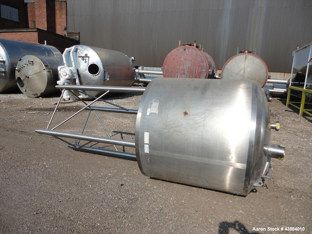 "Used- APV Crepaco Tank, 330 Gallon, Stainless Steel. Approximately 48"" diameter x 42"" straight side, dish top, flat bottom, ..."