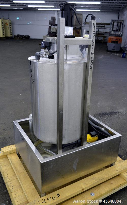 "Used- Tank, 25 Gallon, 304 Stainless Steel, Vertical. Approximate 18"" diameter x 23"" straight side. Flat top with a  hinged ..."