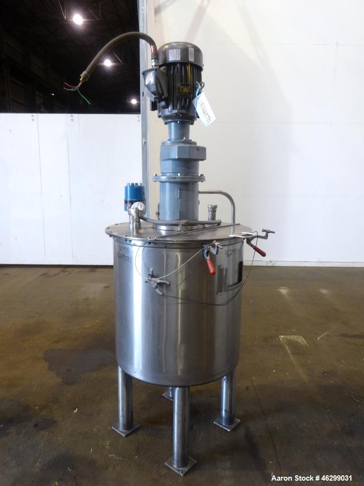 "Used- Tank, Approximately 80 Gallons, 304 Stainless Steel, Vertical. 30"" Diameter x 28"" straight side. Bolt-on flat top with..."