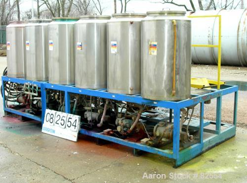 "USED: Multi tank feed system consisting of (7) 75 gallon 304 stainless steel tanks, 24"" diameter x 36"" straight side. Open t..."