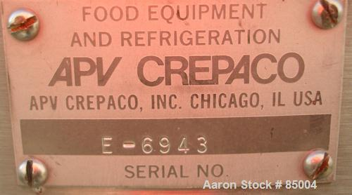 "Used- APV Crepaco Insulated Scraper Mixing Tank, 185 Gallon, 316 Stainless Steel. 40"" diameter x 40"" straight side. Flat top..."