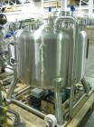 Used- Pure Flo Agitated Receiver, 500 Liter (132 Gallon), 316L Stainless Steel Construction. Approximately 42