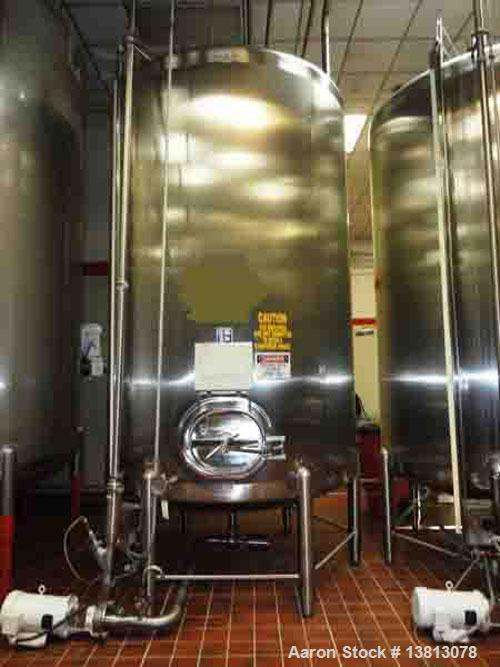 Used-Feldmeier Tank, 3,000 Gallons, 304 Stainless Steel, Vertical.  Dish top and bottom with side manway.  Top mounted off-c...