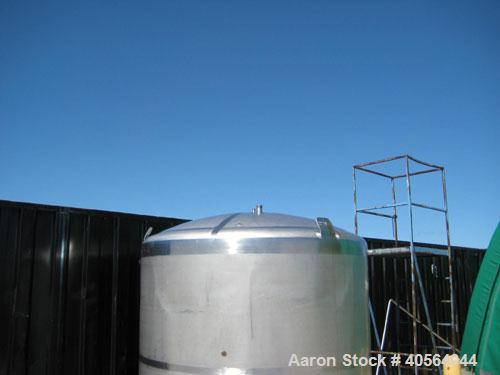 Used- 1,800 gallon vertical slope bottom stainless steel tank, 7 ft diameter x 6.3 ft straight height, dished top on legs wi...