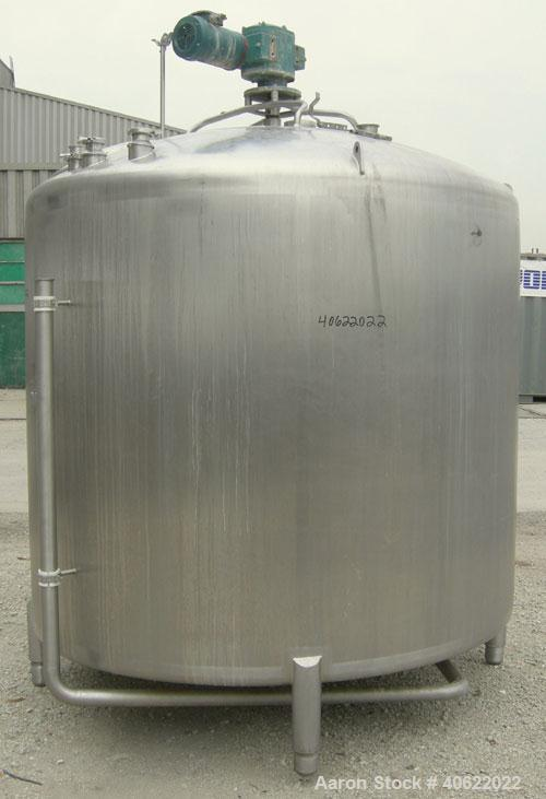 "Used- APV Crepaco Tank, 1500 Gallon, 304 Stainless Steel, Vertical. 84"" diameter x 66"" straight side. Dish top, sloped botto..."