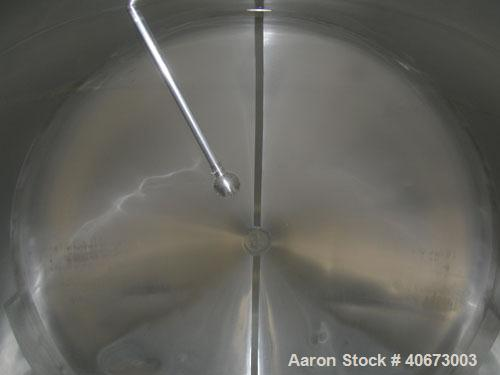 "Used- Delaval tank, 4,803 gallon (4000 Imperial), 304 stainless steel, horizontal.  Approximately 95"" diameter x 144"" straig..."
