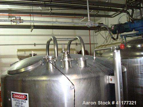 Used-DCI 1000 gallon single wall vertical mixing tank. 6' diameter x 5' straightwall x 10' overall height. (4) stainless ste...