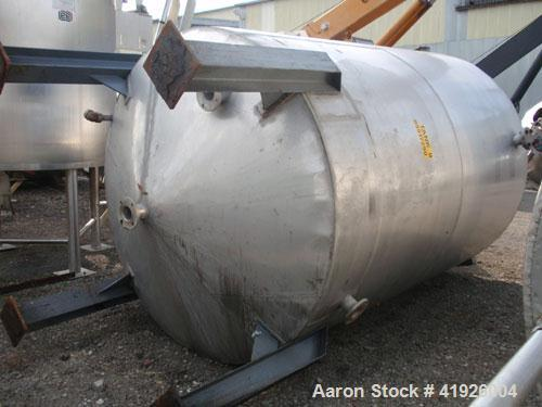"Used- Tank, 2800 Gallon, 316 Stainless Steel, Vertical. 84"" diameter x 116"" straight side, coned top and bottom. Openings: t..."
