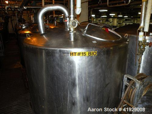 "Used- Tank, 1900 Gallon, stainless steel, vertical. 76"" diameter x 96"" straight side, dished top, coned bottom. Openings: to..."