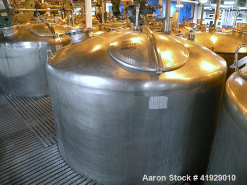 "Used- Mueller Tank, 2000 Gallon, Model F, Stainless Steel, Vertical. 76"" diameter x 106"" straight side, dished top and botto..."