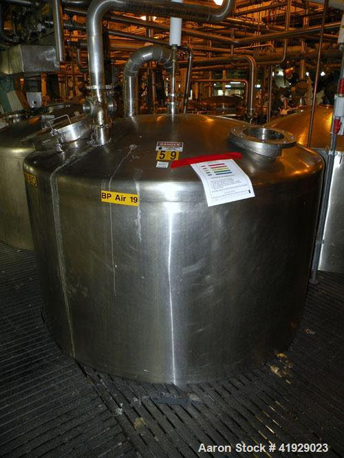 "Used- Mueller Tank, 2000 Gallon, Stainless Steel, Vertical. 76"" diameter x 106"" straight side, dished top and bottom. Openin..."