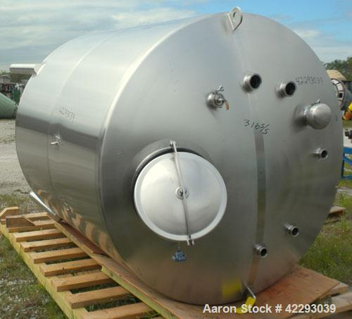 "Used- Tank, 1200 Gallon, 316 Stainless Steel, Vertical. 70"" Diameter x 72"" straight side, dished top and bottom. Openings: t..."