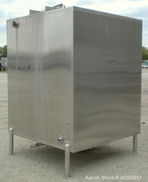"Used- Square Tank, 1400 Gallon, 304 stainless steel, vertical. Approximately 66"" long x 66"" wide x 76"" tall. Flat top and bo..."
