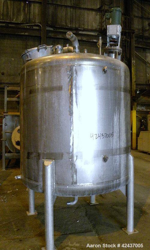 "Used- Tank, 1075 Gallon, 304 Stainless Steel, Vertical. 72"" Diameter x 60"" straight side, dished top and bottom. Off center ..."