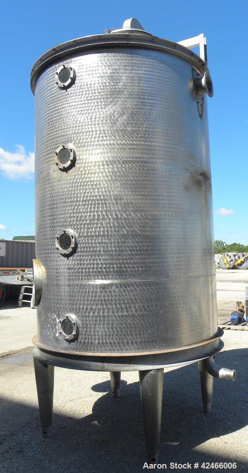 "Used-Tank, 1500 Gallon, 304 Stainless Steel, Vertical. 69"" diameter x 97"" straight side, cone top and sloped bottom. (2) int..."
