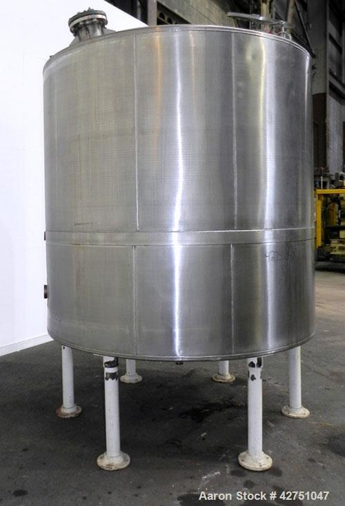 "Used- Tank, 2000 Gallon, 304 Stainless Steel, Vertical. 84"" Diameter x 78"" straight side, dished top, coned bottom. Openings..."