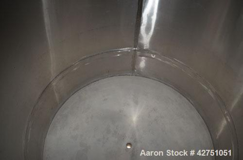 "Used- Tank, 1000 Gallon, Stainless Steel, Vertical. 66"" Diameter x 66"" straight side, dished top, coned bottom. Openings top..."