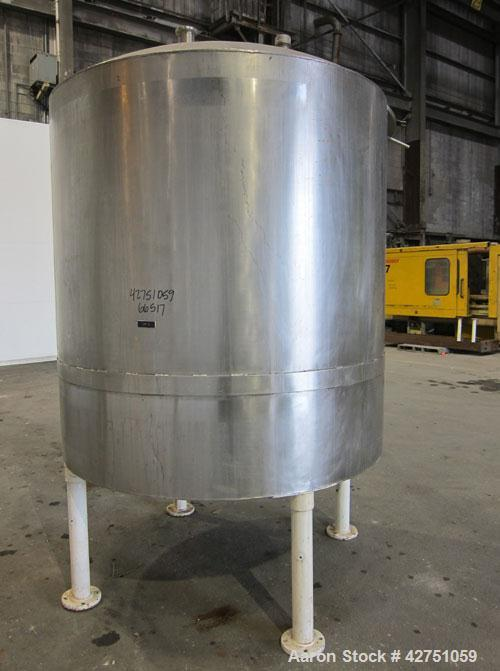 "Used- Tank, 1000 Gallon, 304 Stainless Steel, Vertical. 66"" Diameter x 66"" straight side, dished top, coned bottom. Openings..."