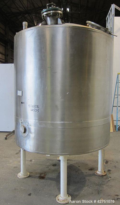 "Used- Tank, 1000 Gallon, 304 Stainless Steel, Vertical. 66"" Diameter x 66"" straight side, dished top, coned bottom. Off cent..."