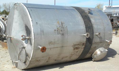 "Used- Tank, 2000 Gallon, 304 Stainless Steel, Vertical. 72"" Diameter x 116"" straight side. Cone top, sloped bottom. Openings..."