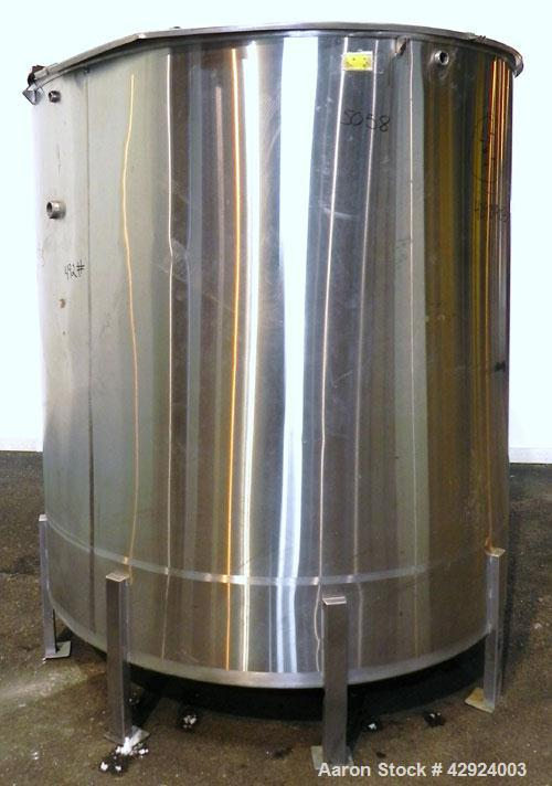 Used- Tank, 1000 Gallon, 316 Stainless Steel, Vertical. Approximate 68'' diameter x 70'' straight side. Open top with a 1 pi...