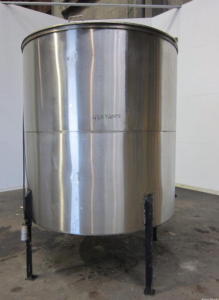 "Used- Tank, 1100 Gallon, 304 Stainless Steel, Vertical. Approximately 68"" diameter x 70"" straight side, flat top with (2) 1/..."