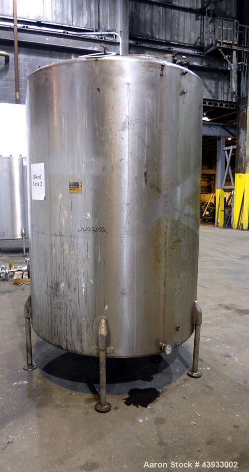 "Used- Tank, 1050 Gallon, 304 Stainless Steel, Vertical.  Approximately 62"" diameter x 82"" straight side.  Dished top, sloped..."