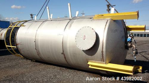 "Used- Tank, 4000 Gallon, 304 Stainless Steel, Vertical.  Approximately 82"" diameter x 180"" straight side, flat welded top, d..."