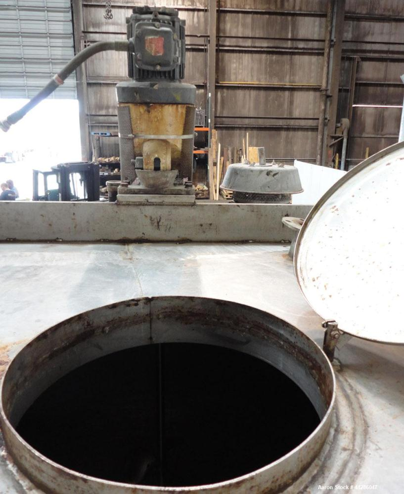 "Used- Tank, 1500 Gallon, 321 Stainless Steel, Vertical. 74"" Diameter x 84"" straight side. Flat top, coned bottom. Off center..."