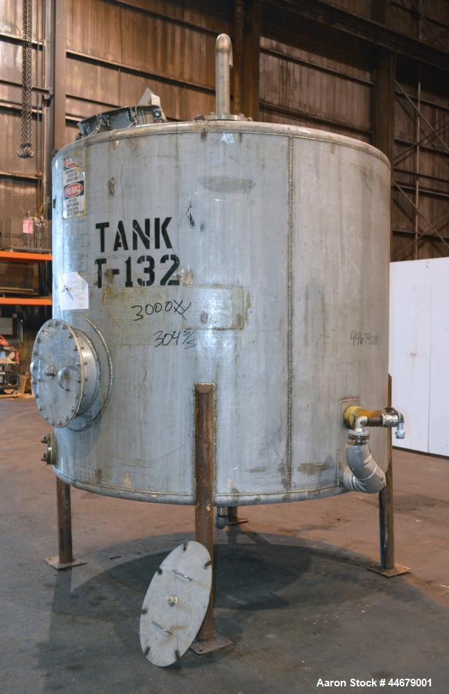 "Used- Tank, 1800 Gallon, 304 Stainless Steel, Vertical. Approximate 84"" diameter x 72"" straight side, coned top and bottom. ..."
