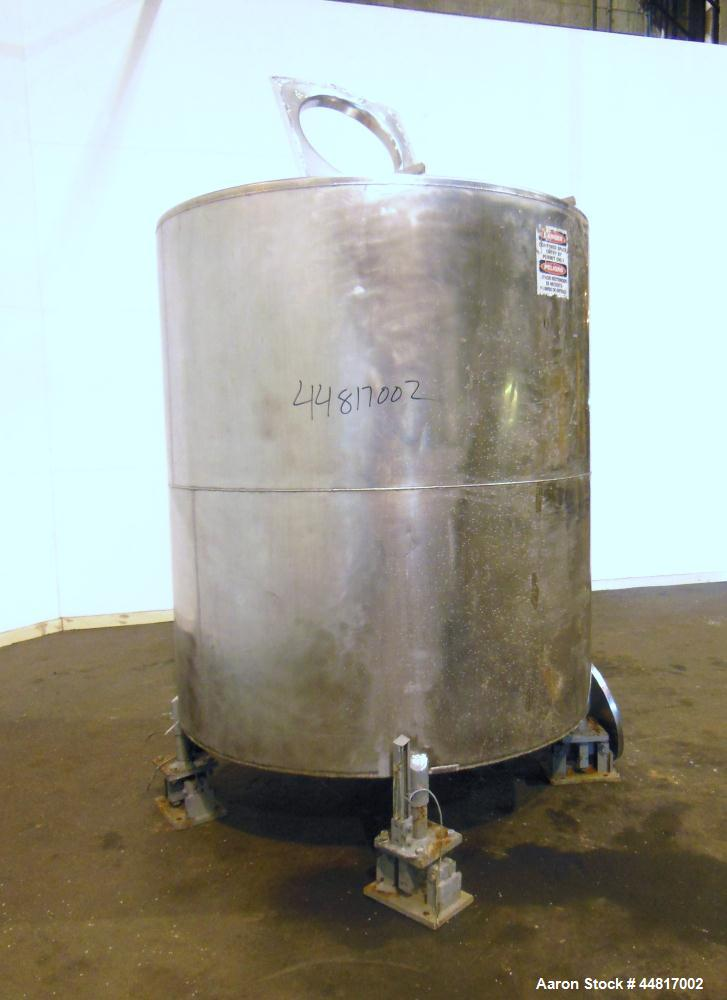 "Used- Tank, 1000 Gallons, 304 Stainless Steel, Vertical. Approximately 67"" diameter x 72"" straight side, flat welded top, sl..."