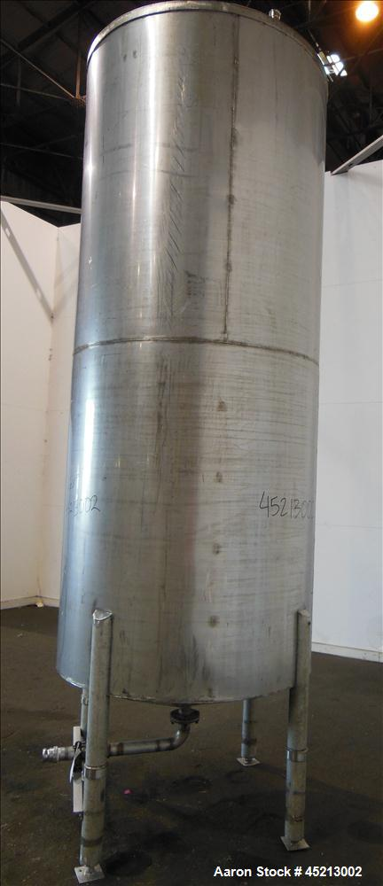 "Used- Tank, 1100 Gallon, 304 Stainless Steel, Verical. 52"" Diameter X 120"" straight side. Coned top and bottom. Openings top..."