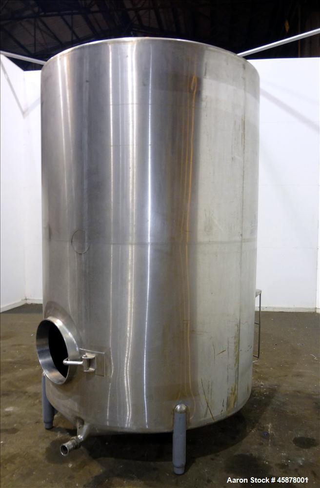 "Used- Tank, Approximate 1400 Gallons, 304 Stainless Steel, Vertical. Approximate 66"" diameter x 93"" straight side, dished to..."
