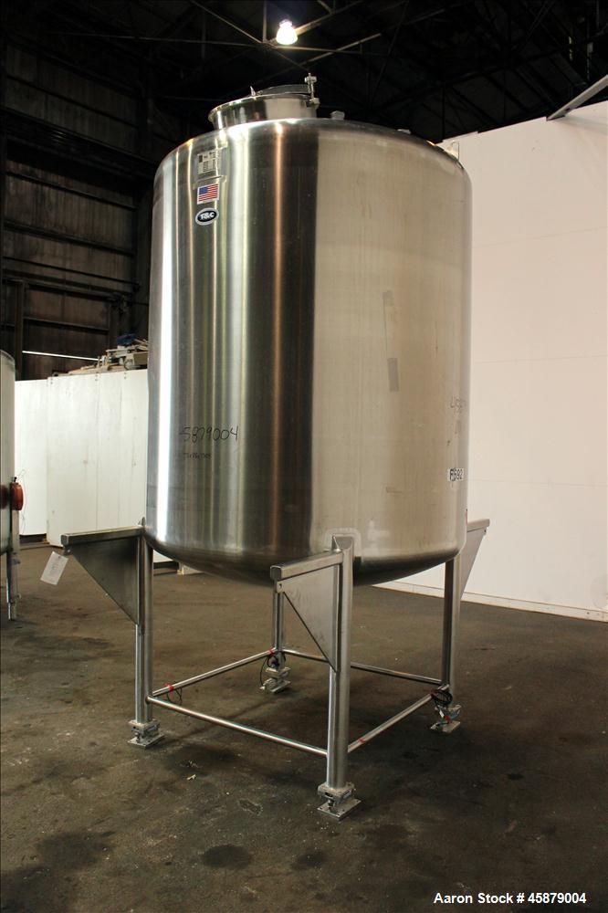 "Used- T&C Stainless Tank, 1,000 Gallon, 316L Stainless Steel, Vertical. Approximately 65"" diameter x 70"" straight side. Dish..."