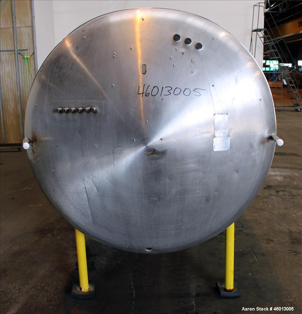 "Used- Zero Milk Cooling Tank, Model NV1500, 1,500 Gallon, 304 Stainless steel, Horizontal. Approximate 52"" diameter x 154"" s..."