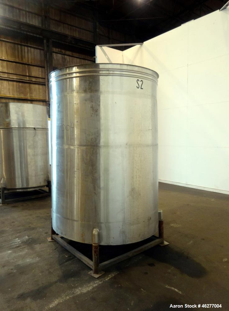 "Used- San-I-Tanks Tank, Approximately 1,150 Gallons, 304 Stainless Steel, Vertical. Approximately 64"" diameter x 81-1/2"" str..."