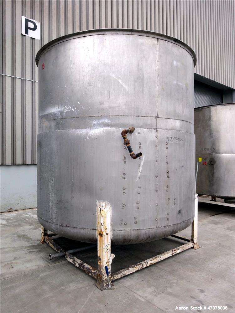 "Used- Tank, Approximate 4500 Gallon, Stainless Steel, Vertical. Approximate 114"" diameter x 106"" straight side. Open top wit..."