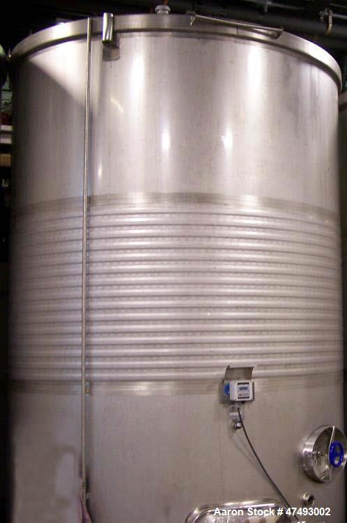 Used- 10,000L Stainless Steel Tank. Jacketed, sloped bottom, man-hole on top, racking door, bottom man-hole. Thermowell, sam...
