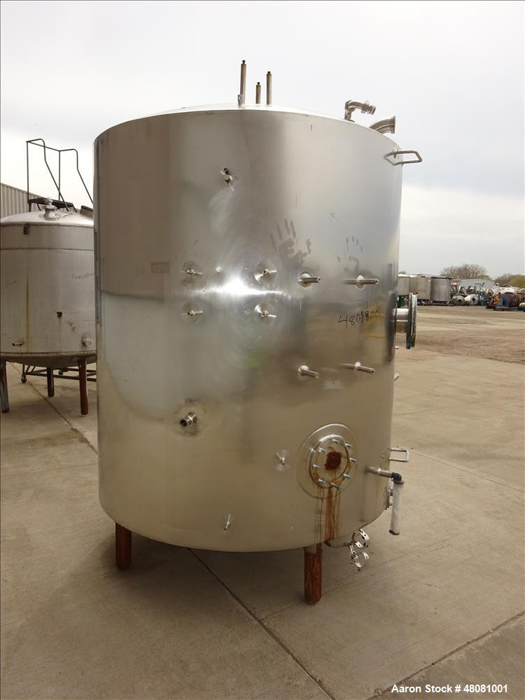 "Used- Tank Approximate 1,000 Gallons, 304 Stainless Steel, Vertical. Approximate 67"" diameter x 70"" straight side, dish top,..."