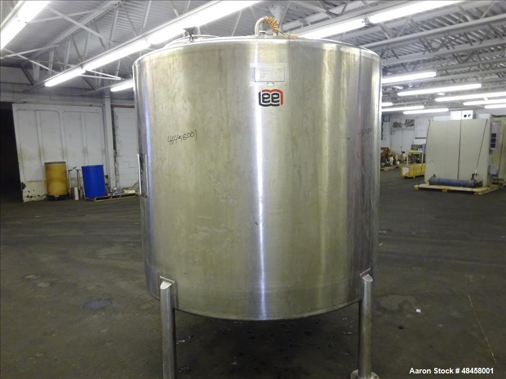 "Used- Lee Industries Tank, 1000 Gallon Stainless Steel, Vertical. Approximate 74"" diameter x 62"" straight side, dished top a..."